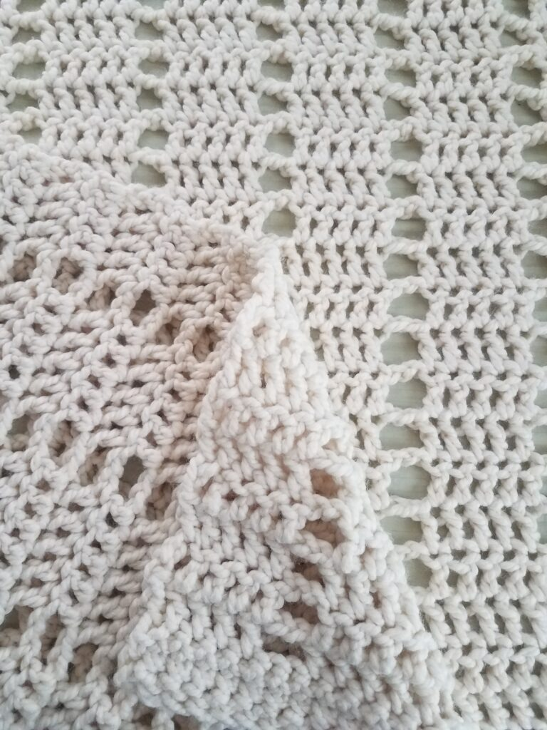Big Sur Crochet Blanket by Kind Of Knit made using DC crochet stitch