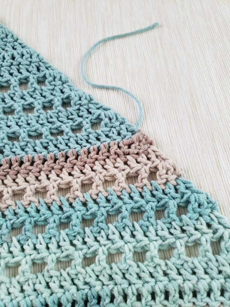 How to weave in the ends on an edge of the project with two different colors