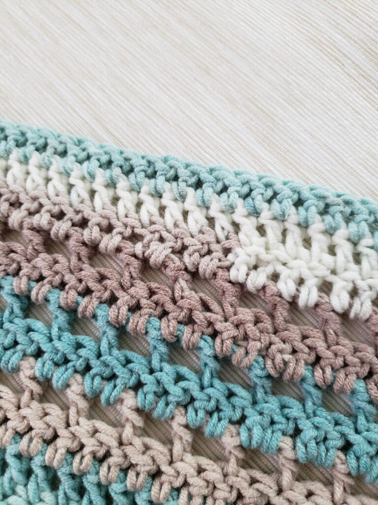 How to weave in the ends in the middle of a crochet project